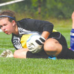 COVERING UP — Lake Region goalie Emily Bartlett secures the ball following a shot during last week's soccer game against rival Fryeburg Academy. (Rivet Photo)