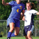 MAKING A MOVE — Lake Region's Sydney Hancock (left) attempts to make a move past Fryeburg Academy defender Bri Pelkie. (Rivet Photo)