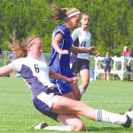 SLIDING TO THE RAIDERS' DEFENSE — Fryeburg Academy's Abby Smith (#6) knocks the ball away from a charging Jacqui Black of Lake Region during last week's meeting between the two rivals. The game ended in a scoreless tie. (Rivet Photo)