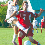 TOO LATE TO STOP STEFAN — With a Gray-New Gloucester defender closing in, Fryeburg Academy's Stefan Sjekloca manages to get a shot off. Sjekloca scored a goal on Monday to lead the Raiders to a 2-0 win over Poland to improve to 2-1. (Rivet Photo)