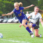 TRIPPED UP — Lake Region's Hannah Perkins (left) hits the turf after taking a bump from Fryeburg Academy's Abby Smith during last week's varsity soccer game at the Academy. Neither team could mount many scoring opportunities, and despite two overtime sessions, the Lakers and Raiders settled for a tie. (Rivet Photo)
