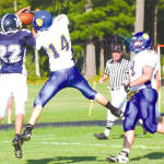 BATTLE FOR THE BALL — Lake Region receiver Mike Triglione (#14) tries to haul in a second quarter catch for a possible touchdown, but the ball was intercepted by Fryeburg Academy's Tyler Nadeau in the end zone. Nadeau had two interceptions on the day as the Raiders claimed the Pleasant Mountain Bowl Cup with a 20-16 victory. (Rivet Photo)
