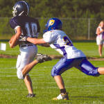 LESSON ON NEVER GIVING UP ON A PLAY — Fryeburg Academy quarterback Andrew Rascoe (#10) appeared to have a touchdown during the annual Pleasant Mountain Bowl, but he was hauled down from behind by Lake Region's Kyle Stevens, who didn't give up on the play. Although Fryeburg Academy recovered the loose ball, Stevens' hustle and saving tackle proved to be a big one as the Laker defense held to keep the game close during last Friday's season opener in Fryeburg. (Rivet Photos)