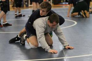 FAMILY AFFAIR — Connor and brother, Zach (bottom), go through a warm up prior to the Class B state finals at the Academy. (Rivet Photo)