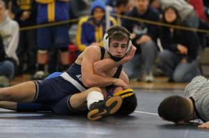 NE CHAMP — Connor Sheehan, a senior at Fryeburg Academy, closed out his high school career with a New England championship Saturday. Here, Connor wrestles in the Maine Class B state tournament. (Rivet Photo)