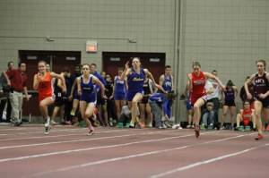 SPEEDSTER — Kate Hall, a sophomore at Lake Region (center) set a new Maine 55-meter sprint record and won a New England title in Boston Saturday. Here, she is pictured at the Class B state meet held at Bates College in Lewiston. (Rivet Photo)