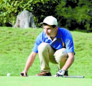 SULLIVAN TIDD sizes up his putt attempt during varsity golf action at Bridgton Highlands.