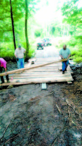 ON SUNDAY — a crew of about six men extended the Otisfield Bridge to battle erosion at that spot along the trail system that is part of JugTown. Those who helped with the work last weekend included: Bill Chute, Lonney Girard, Ernest Hinkley II, Jay Morse, Eric Lacrasse and David Hicks. (Photo courtesy of Bill Chute)