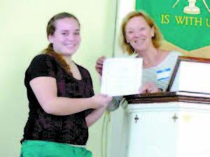 IRISH AWARD RECIPEINT — Anna Williams receives the 2014 Joan Irish Award from Moira Yip of the Kezar Lake Watershed Association.