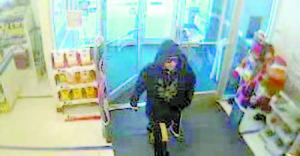 KEY EVIDENCE — This surveillance photo, taken Nov. 28, 2013, shows the suspect in the robbery of the Bridgton Rite Aid. A 26-year-old Gardiner man has been indicted for the crime.