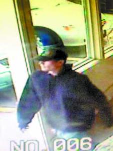 SURVEILLANCE photo of the suspected purse snatcher.