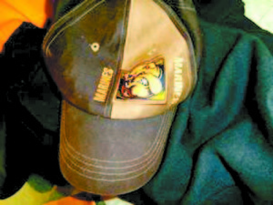 CLOSE UP of the ball cap that the alleged purse snatcher was wearing.