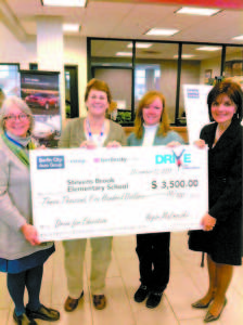 "EEKING AWAY AT IT — From left, SAD 61 School District Assistant Superintendent Deb Howard holds a $3,500 donation check from Berlin City Auto, along with Stevens Brook Elementary School Academic Leader Liz Shane, Grade 4 Teacher Jessica Hunt and SBES Principal Cheryl Turpin. The money is part of $10,000 raised to date for the school's Greenhouse Project. The next fundraising effort for the project will take place Thursday, Feb. 12, form 5 to 7:30 p.m., when Turpin and six teachers will host a ""McTeachers' Night"" at McDonald's restaurant on Portland Road in Bridgton."