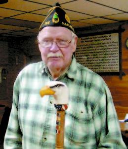 WORLD WAR II VETERAN — Fred Gilman receives a custom-carved eagle cane on Tuesday evening. (De Busk Photo)