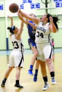 NICOLE BENNETT of Fryeburg Academy blocks a shot attempt by Lake Region's Chandler True.