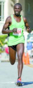 Moninda Marube, 37, of Auburn won his third Bridgton four miler in 20:40. (Rivet Photos)